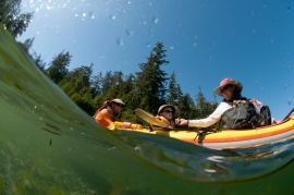 family in triple kayak