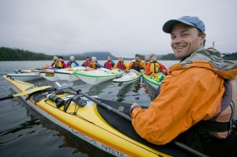 David Pinel kayaking with a group