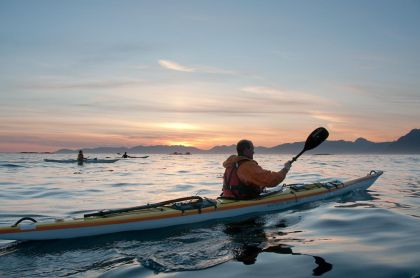 David Pinel kayaking with sunset