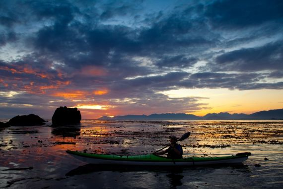 sea kayaker with sunset in Kyuquot, BC