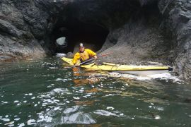 sea kayaking near rock arches and caves