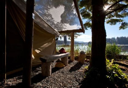 waterfront canvas tent with morning sunshine